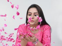 Asian woman with rose petals Royalty Free Stock Images