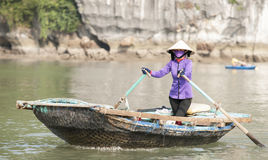Asian woman rowing on bay Stock Photography