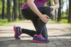 Asian woman runner hold Knee Pain ,Human Leg Royalty Free Stock Photography