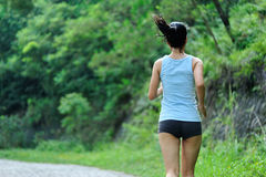 Asian woman runner running outdoor. In the morning Royalty Free Stock Images