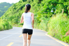 Asian woman runner running outdoor. Asian young woman runner running outdoor in the morning Royalty Free Stock Photo
