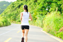 Asian woman runner running outdoor Stock Photo