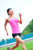 Asian woman runner running Royalty Free Stock Photos