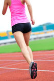 Asian woman runner running. In sports ground outdoor Royalty Free Stock Images