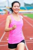 Asian woman runner running Stock Photos