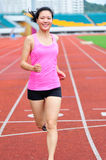 Asian woman runner running. In sports ground outdoor Royalty Free Stock Image