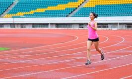 Asian woman runner running. In stadium Royalty Free Stock Images