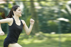 Asian woman running. Stock Image