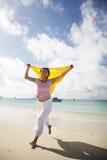 Asian Woman running on the beach Stock Photos
