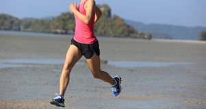 Asian woman running on beach Stock Photos