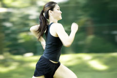 Asian woman running. Blurred by motion Royalty Free Stock Photo