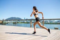 Asian Woman running in city of Hong Kong Royalty Free Stock Photo