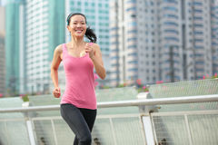 Asian woman running in city Stock Photo