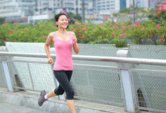 Asian woman running in city Stock Image