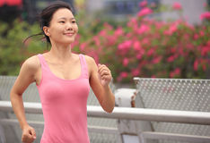 Asian woman running in city Royalty Free Stock Image