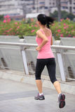 Asian woman running in city Royalty Free Stock Photo
