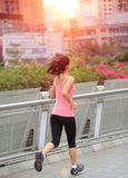 Asian woman running in city Royalty Free Stock Images