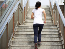 Asian  woman running on escalator stairs Royalty Free Stock Photography