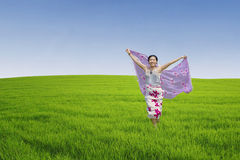 Asian woman running on green field Stock Photography