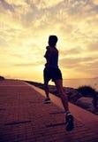 Asian woman running Stock Image