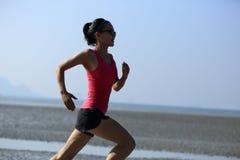 Asian woman running Stock Photo