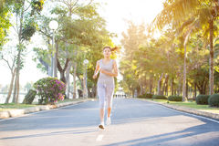 Asian woman running Stock Images