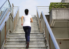 Asian  woman running on stairs Stock Images