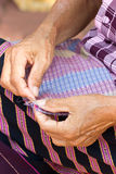 Asian Woman's Hand Sewing. Stock Photos