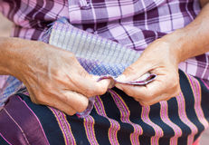 Asian Woman's Hand Sewing. Royalty Free Stock Images
