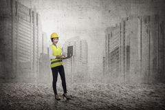 Asian woman in safety vest posing Royalty Free Stock Photography