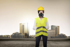 Asian woman in safety vest posing Royalty Free Stock Photo
