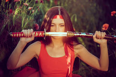 Asian woman with samurai sword on the nature Royalty Free Stock Photo
