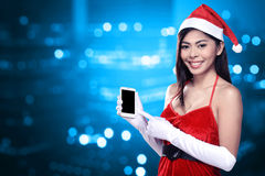 Asian woman in santa claus costume holding cellphone Royalty Free Stock Images