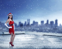 Asian woman in santa claus costume. Standing on building rooftop Royalty Free Stock Photos