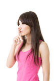 Asian woman saying hush be quiet Royalty Free Stock Photo