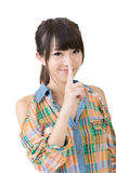 Asian woman saying hush be quiet. Isolated on the white background Stock Photo