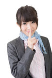 Asian woman saying hush be quiet. Isolated on the white background Stock Images