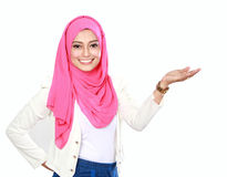 Asian woman with scarf presenting Stock Photo