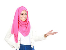 Asian woman with scarf presenting. Copyspace isolated over white background Stock Photography