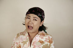 Asian woman screaming. In fear Royalty Free Stock Photo