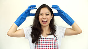 Asian woman screaming and stress from doing housework chores Royalty Free Stock Images