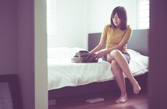 Asian woman searching wallet under bed lost thing,Happy and smiling. Asian female searching wallet under bed lost thing,Happy and smiling stock photo