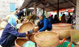 Asian woman selling bamboo basket at market Royalty Free Stock Photo