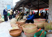 Asian woman selling bamboo basket at market Royalty Free Stock Photography