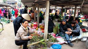 Asian woman selling betel nut at market Stock Image