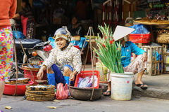 Asian woman selling fresh fish in the market in Vietnam Royalty Free Stock Photo
