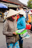 Asian woman selling fresh fish in street market in Vietnam Royalty Free Stock Image