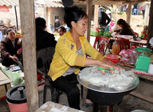 Asian woman selling rice cake in the market Stock Images
