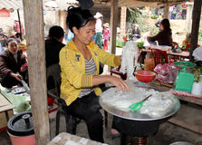 Asian woman selling rice cake in the market Royalty Free Stock Photography
