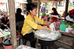 Asian woman selling rice cake in the market Royalty Free Stock Photo